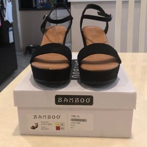 Bamboo black suede size 8 wedges.